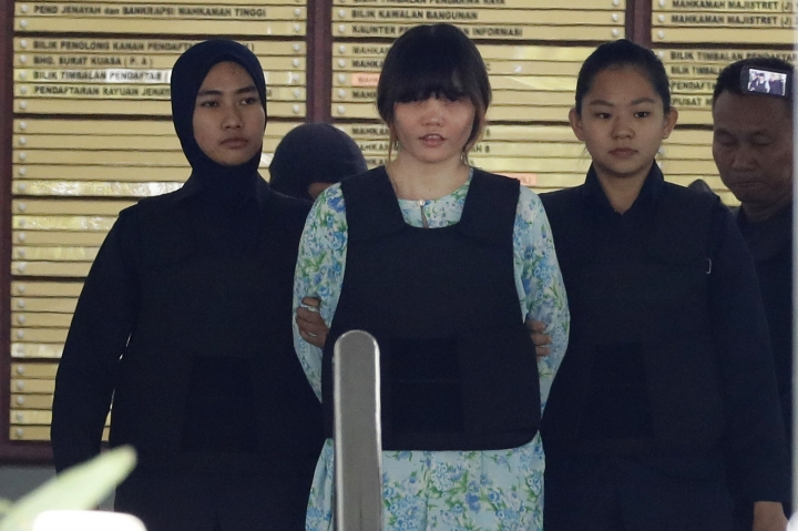 Vietnamese Doan Thi Huong, center, is escorted by police as she leave the court house in Shah Alam, Malaysia, Tuesday, Oct. 3, 2017. Thi Huong and Siti Aisyah of Indonesia pleaded not guilty as their trial opened Monday in the killing of Kim, widely thought to have been orchestrated by his half brother, North Korea's third-generation leader Kim Jong Un. (AP Photo/Vincent Thian)