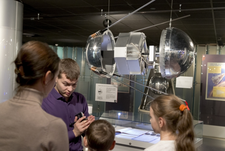 In this photo made on Monday, Oct. 2, 2017, a guide tells students about a mock-up of the First Earth Sputnik in the Museum of Cosmonautics in Moscow, Russia. The launch of Sputnik 60 years ago opened the space era and became a major triumph for the Soviet Union, showcasing its military might and technological edge. (AP Photo/Ivan Sekretarev)