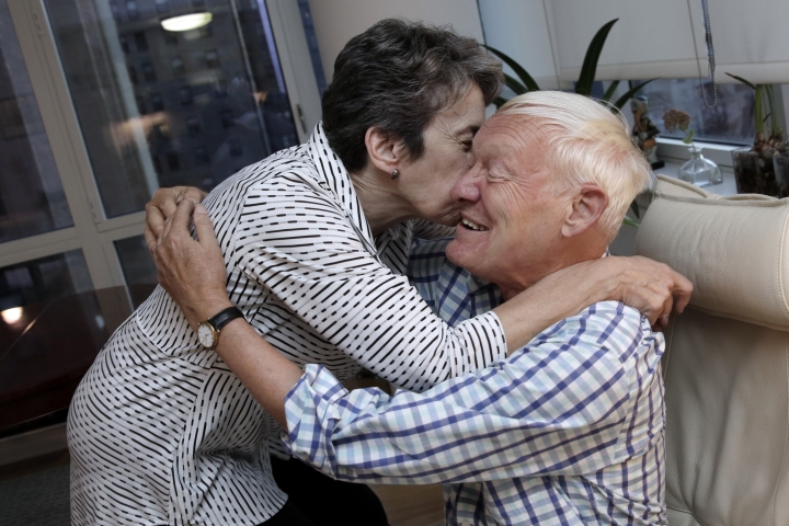 Joachim Frank, of Columbia University, embraces his wife Carol Saginaw, in their New York City apartment, Wednesday, Oct. 4, 2017. Frank shares this year's Nobel Chemistry Prize with two other researchers for developing a method to generate three-dimensional images of the molecules of life. (AP Photo/Richard Drew)