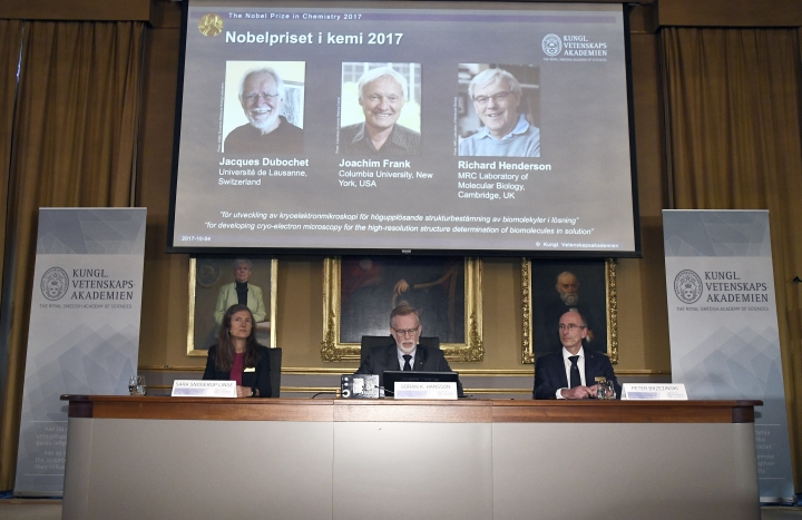 From left, Sara Snogerup Linse, chairman of the Nobel Committee in Chemistry, Goran K. Hansson, secretary of the Royal Academy of Sciences, and Peter Brzezinski, member of the Nobel Committee, sit during a press conference as they announce - Jacques Dubochet - from the University of Lausanne, Switzerland, Joachim Frank from Columbia University, USA and Richard Henderson, from the MRC Laboratory of Molecular Biology, Cambridge, in England as the winners of the 2017 Nobel Prize in Chemistry, at the Royal Academy of Sciences in Stockholm, Wednesday, Oct. 4, 2017. The Nobel Prize for Chemistry rewards researchers for major advances in studying the infinitesimal bits of material that are the building blocks of life. (Claudio Bresciani/TT News Agency via AP)