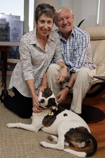 Joachim Frank, of Columbia University, poses for a photo with his wife Carol Saginaw, and their dog Daisy, in their New York City apartment, Wednesday, Oct. 4, 2017. Frank shares this year's Nobel Chemistry Prize with two other researchers for developing a method to generate three-dimensional images of the molecules of life. (AP Photo/Richard Drew)