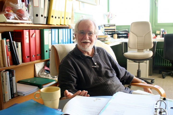 In this picture released by the University of Lausanne, Switzerland, Jacques Dubochet, chemistry professor at the University of Lausanne (UNIL), poses in his office, in Lausanne, Switzerland, in 2006. Three researchers based in the U.S., U.K. and Switzerland won the Nobel Prize in Chemistry on Wednesday Oct. 4, 2017 for developments in electron microscopy. The 9-million-kronor ($1.1 million) prize is shared by Jacques Dubochet of the University of Lausanne, Joachim Frank at New York's Columbia University and Richard Henderson of MRC Laboratory of Molecular Biology in Cambridge, Britain. (University of Lausanne/Keystone via AP)