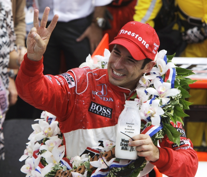 FILE - In this May 24, 2009, file photo, Helio Castroneves, of Brazil, holds up three fingers after winning his third Indianapolis 500 auto race, at Indianapolis Motor Speedway in Indianapolis, Ind. Three-time Indianapolis 500 winner Helio Castroneves will move to Team Penske's sports car program next season, bringing his 20-year full-time IndyCar career to an end. Castroneves will still drive for Penske at the Indianapolis 500. (AP Photo/Darron Cummings, File)