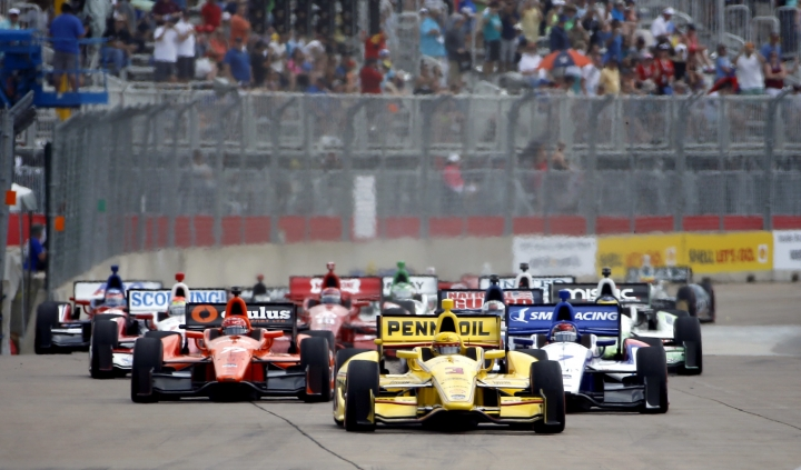 FILE - In this June 29, 2014, file photo, Helio Castroneves (3) of Brazil leads the pack from the pole position at the start of the second IndyCar Grand Prix of Houston auto race, in Houston. Three-time Indianapolis 500 winner Helio Castroneves will move to Team Penske's sports car program next season, bringing his 20-year full-time IndyCar career to an end. Castroneves will still drive for Penske at the Indianapolis 500.(AP Photo/David J. Phillip, File)