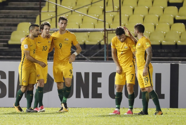 Australia's Robbie Kruse, second from left, celebrate with teammate after scoring the first goal during the 2018 World Cup qualifying soccer match between Syria and Australia at the Hang Jebat Stadium in Melaka, Malaysia, Thursday, Oct. 5, 2017. (AP Photo/Vincent Thian)