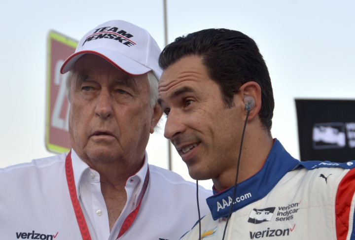FILE - In this June 10, 2017, file photo, team owner Roger Penske, left, talks with driver Helio Castroneves, of Brazil, on pit road before an IndyCar auto race at Texas Motor Speedway in Fort Worth, Texas. Three-time Indianapolis 500 winner Helio Castroneves will move to Team Penske's sports car program next season, bringing his 20-year full-time IndyCar career to an end. Castroneves will still drive for Penske at the Indianapolis 500. (AP Photo/Randy Holt, File)