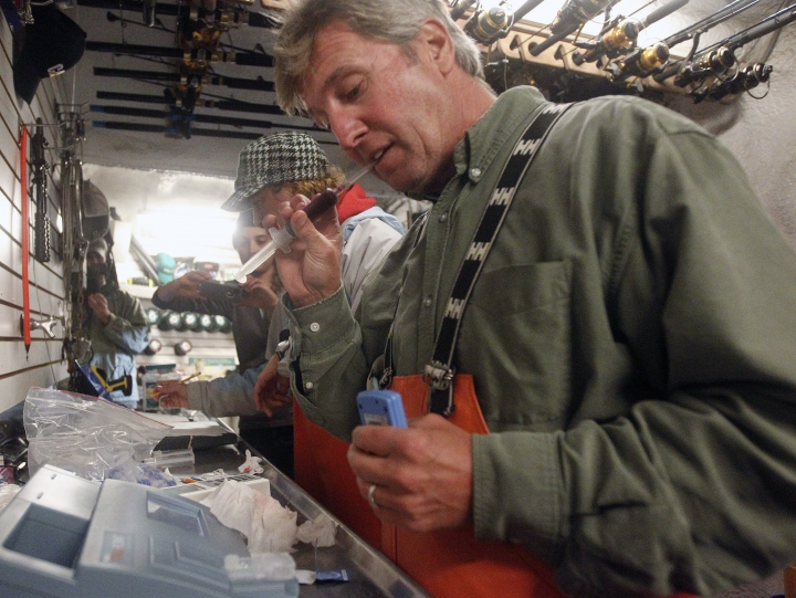 FILE — In this Sept. 13, 2012 file photo, Massachusetts shark expert Greg Skomal pulls the cap off a blood sample taken from an Atlantic great white shark before performing blood gas analysis moments after the nearly 15-foot, 2,292-pound shark was released from the research vessel Ocearch off the coast of Chatham, Mass. Researchers in Massachusetts say great white sharks in the Atlantic Ocean are venturing offshore farther, with more frequency and at greater depths than previously known. The findings were published Sept. 29, 2017, in the scientific journal Marine Ecology Progress Series. (AP Photo/Stephan Savoia, File)