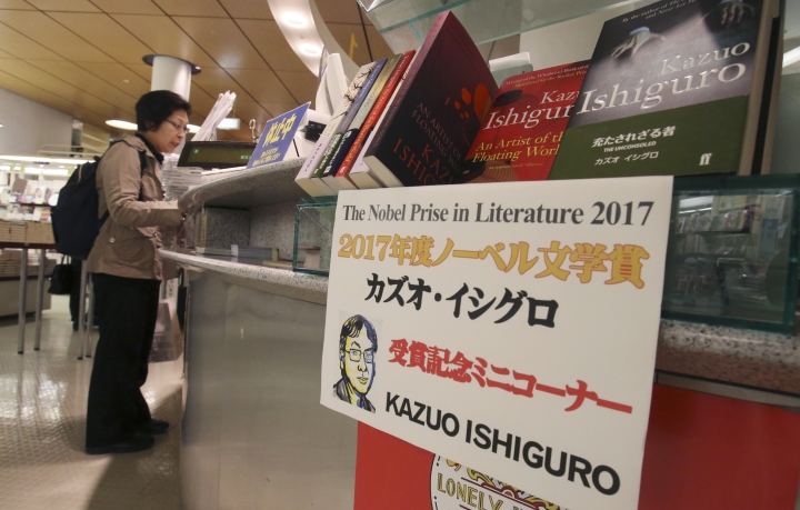 Books written by British writer Kazuo Ishiguro are on display at a bookstore in Tokyo, Friday, Oct. 6, 2017. Ishiguro was born in Nagasaki but raised and educated in England. He was awarded the Nobel Prize on Thursday. (AP Photo/Koji Sasahara)