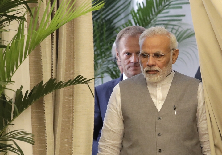 Indian Prime Minister Narendra Modi, front, followed by President of the European Council Donald Tusk arrive for signing of agreement ceremony after their meeting in New Delhi, India, Friday, Oct. 6, 2017. The European Union and India will step up efforts to counter violent extremism and radicalization, particularly online, and enhance military cooperation for maritime security in the Indian Ocean and beyond. (AP Photo/Manish Swarup)