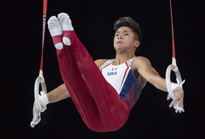 Yul Moldauer of the United States performs on the rings in the men's individual all-around final at the World Artistic Gymnastics Championships in Montreal on Thursday, Oct. 5, 2017. (Paul Chiasson/The Canadian Press via AP)