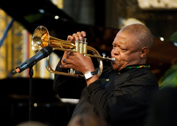 FILE - In this March 2012 file photo South African musician Hugh Masekela performs during the Observance for Commonwealth Day service at Westminster Abbey in central London. Masekela says he is canceling commitments in the near future because he needs all his energy to continue treatment for prostate cancer. (Leon Neal, Pool Photo via AP, File)
