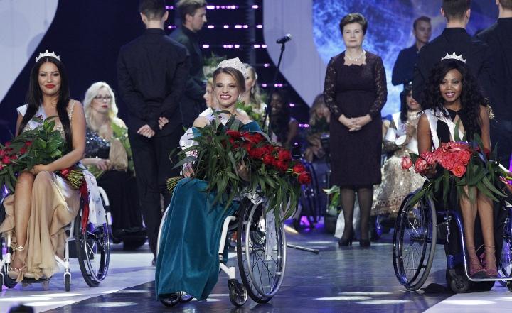 Miss Wheelchair World 2017 winner Aleksandra Chichikova, center, from Belarus, with second placed Lebohang Monyatsi, right, from South Africa and third placed Adrianna Zawadzinska, left, from Poland during the Miss Wheelchair World 2017 beauty pageant final in Warsaw, in Warsaw, Poland, Saturday, Oct. 7, 2017. (AP Photo/Czarek Sokolowski)