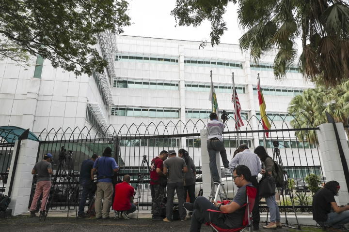 Journalists wait outside a laboratory in Petaling Jaya, Malaysia, Monday, Oct. 9, 2017. The trial of two women accused of killing the estranged half brother of North Korea's leader entered its second week Monday, with the court moving temporarily to the high-security laboratory to view evidence contaminated with VX nerve agent. (AP Photo/Vincent Thian)