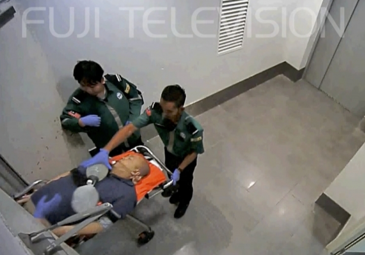 In this image made from Feb. 13, 2017, video provided by Fuji TV, Kim Jong Nam, half-brother of North Korean leader Kim Jong Un, is stretchered at Kuala Lumpur International Airport in Sepang, Malaysia. Japan's Fuji TV broadcast on Sunday, Oct. 8, 2017, what it described as exclusive airport security videos showing an unconscious Kim being taken on a stretcher to an elevator. It said he was being taken to an ambulance to be transported to a hospital. Kim died on the way to the hospital. (Fuji TV via AP)