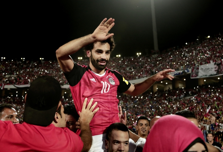 Egypt's Mohamed Salah celebrates defeating Congo during the 2018 World Cup group E qualifying soccer match at the Borg El Arab Stadium in Alexandria, Egypt, Sunday, Oct. 8, 2017. Egypt won 2-1. (AP Photo/Nariman El-Mofty)