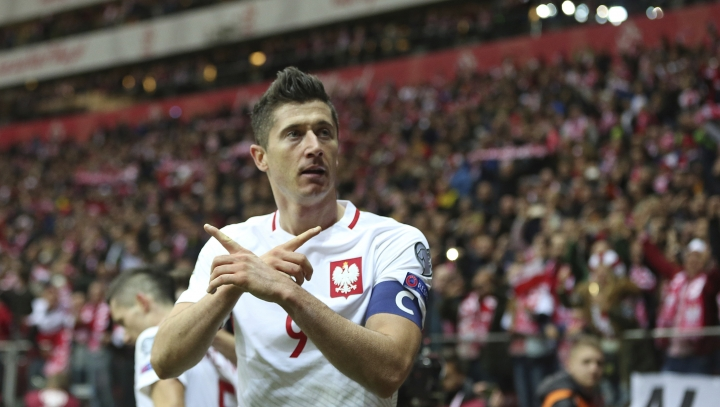 Poland's Robert Lewandowski reacts after he scored a goal during the World Cup Group E qualifying soccer match between Poland and Montenegro at National stadium in Warsaw, Poland, Saturday, Oct. 8, 2017.(AP Photo/Czarek Sokolowski)