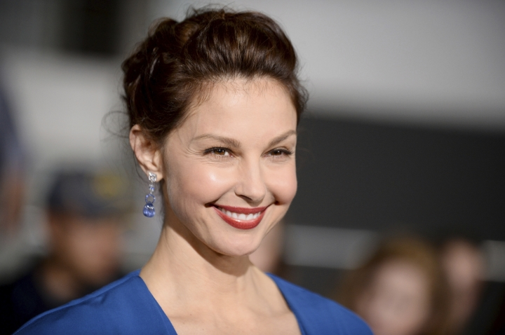 "FILE - In this March 18, 2014, file photo, Ashley Judd arrives at the world premiere of ""Divergent"" at the Westwood Regency Village Theater in Los Angeles. Harvey Weinstein has been fired from The Weinstein Co., effective immediately, following new information revealed regarding his conduct, the company's board of directors announced Sunday, Oct. 8, 2017. The New York Times article chronicled allegations against Weinstein from film star Ashley Judd and former employees at both The Weinstein Co. and Weinstein's former company, Miramax. (Photo by Jordan Strauss/Invision/AP, File)"