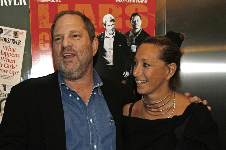 "FILE - In this Aug. 22, 2007, file photo, Harvey Weinstein and Donna Karan arrive at the premiere of ""The Hunting Party"" at the Paris Theater in New York. Karan apologized on Monday, Oct. 10, 2017, after offering praise for Weinstein the night before following his firing from his company amid allegations of sexual harassment lasting decades. (AP Photo/Rick Maiman, File)"