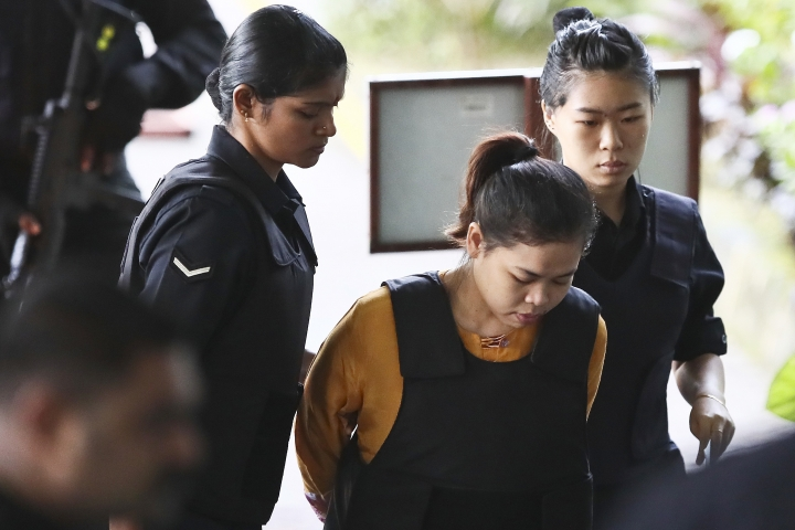 Indonesian Siti Aisyah, center, is escorted by police as she arrives for court hearing at Shah Alam court house in Shah Alam, outside Kuala Lumpur, Malaysia Tuesday, Oct. 10, 2017. Aisyah and Doan Thi Huong of Vietnam, accused of killing the estranged half brother of North Korea's leader, pleaded not guilty at the start of the trial last week to charges of murder that carry a mandatory death sentence if they are convicted. (AP Photo/Sadiq Asyraf)