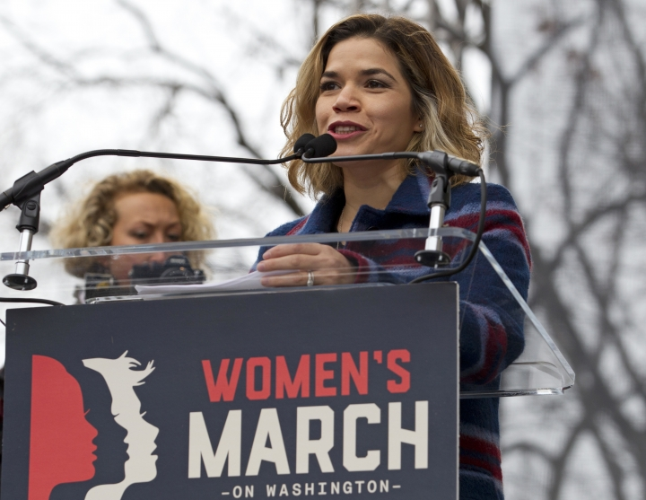 "FILE - In this Saturday, Jan. 21, 2017, file photo, Actress America Ferrera speaks to the crowd during the women's march rally, in Washington. Ferrera, Roxane Gay and Jill Soloway are among those contributing essays to a book marking the one-year anniversary of January's Women's March. Dey Street, an imprint of William Morrow, told The Associated Press on Tuesday, Oct. 10, that ""Together We Rise"" will come out Jan. 16, 2018. (AP Photo/Jose Luis Magana, File)"