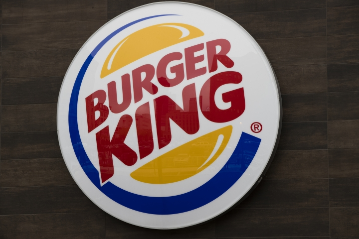 This Friday, Oct. 21, 2016, photo shows a Burger King restaurant logo in Philadelphia. Burger King is adding spicy nuggets to its menu and firing up a rivalry with burger chain Wendy's, which pulled the peppery snack from most of its restaurants earlier in 2017. (AP Photo/Matt Rourke)