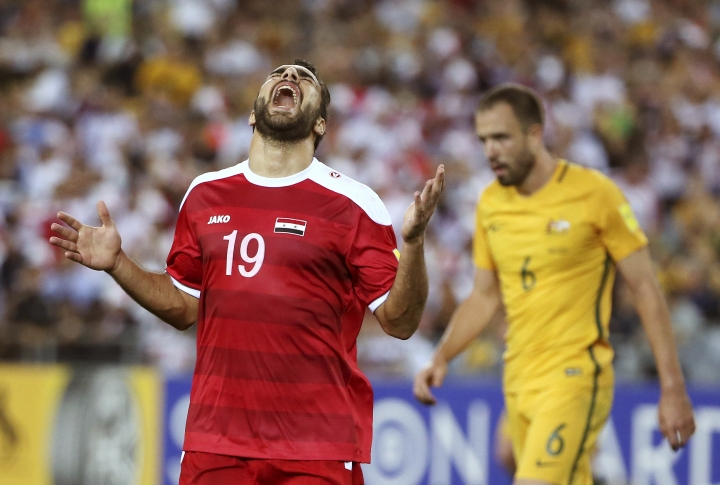 Syria's Mardek Mardkian yells out after missing a chance on the Australian goal during their Soccer World Cup qualifying match in Sydney, Australia, Tuesday, Oct. 10, 2017. (AP Photo/Rick Rycroft)