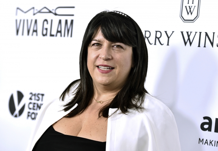 "FILE - In this Oct. 29, 2015 file photo, author E L James arrives at the amfAR Inspiration Gala in Los Angeles. Vintage Books announced Tuesday, Oct. 10, 2017, that the next ""Fifty Shades"" novel, ""Darker: Fifty Shades Darker as Told by Christian"" will come out Nov. 28. ""Grey,"" published in 2015, also was told from Christian's point of view. James said in a statement that the new book would give readers a ""darker and more haunted"" take on Christian. (Photo by Jordan Strauss/Invision/AP, File)"
