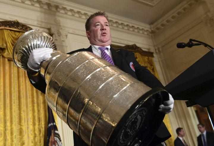 Mike Bolt holds the Stanley Cup near where is will be displayed in the East Room of the White House in Washington, Tuesday, Oct. 10, 2017, in preparation for a visit by the 2017 NHL Stanley Cup Champion Pittsburgh Penguins with President Donald Trump. Bolt is one of the four keepers of the Cup, whose job it is to protect the 35-pound, silver trophy that has nearly three thousand names engraved on the bands that surround it. (AP Photo/Susan Walsh)
