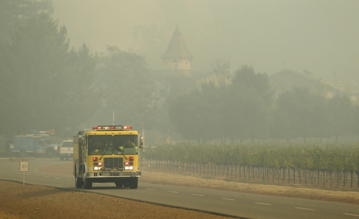A fire truck makes its way through the Chateau St. Jean winery, Tuesday, Oct. 10, 2017, in Kenwood, Calif. Workers in Northern California's renowned wine country picked through charred debris and weighed what to do with pricey grapes after wildfires swept through lush vineyards and destroyed at least two wineries and damaged many others. (AP Photo/Eric Risberg)