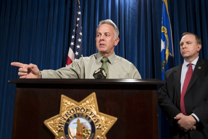 Clark County Sheriff Joe Lombardo, left, with Aaron C. Rouse, special agent in charge for the FBI in Nevada, discusses the Route 91 Harvest festival mass shooting at the Las Vegas Metropolitan Police Department headquarters in Las Vegas, Monday, Oct. 9, 2017. Law enforcement authorities on Monday made a significant change to the timeline of the mass shooting, saying the gunman shot a hotel security guard before he opened fire on concertgoers. (Erik Verduzco/Las Vegas Review-Journal via AP)