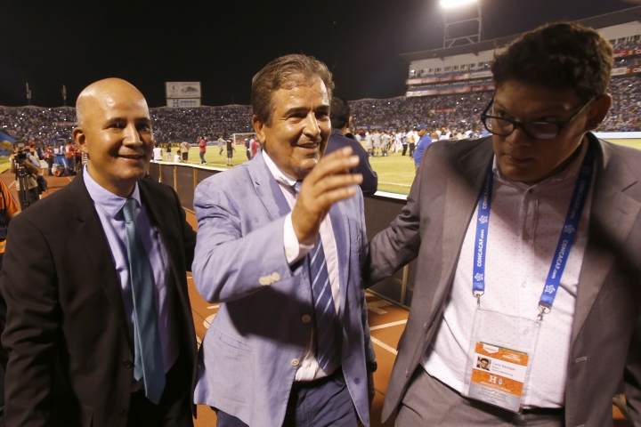 Honduras coach Jorge Luis Pinto, center, walk off the pitch after his team defeated Mexico, 3-2, after a World Cup qualifying soccer match in San Pedro Sula, Honduras, Tuesday, Oct. 10, 2017. (AP Photo/Moises Castillo)