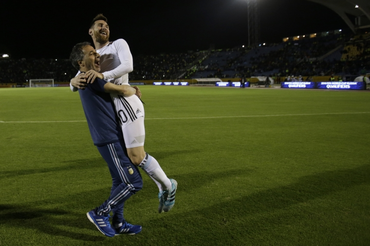 Argentina's Lionel Messi is carried by an unidentified member of his team after beating Ecuador during their 2018 World Cup qualifying soccer match at the Atahualpa Olympic Stadium in Quito, Ecuador, Tuesday, Oct. 10, 2017. (AP Photo/Dolores Ochoa)