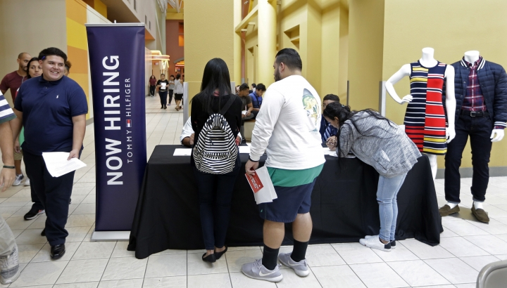 In this Tuesday, Oct. 3, 2017, photo, job seekers check in at a booth at a job fair at the Dolphin Mall in Sweetwater, Fla. On Wednesday, Oct. 11, 2017, the Labor Department reports on job openings and labor turnover for August. (AP Photo/Alan Diaz)