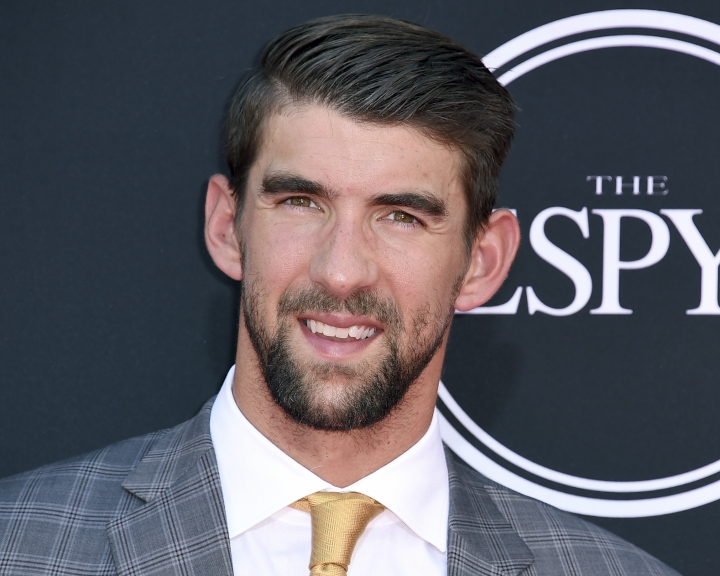 """FILE - In this July 12, 2017 file photo, Olympic swimmer Michael Phelps arrives at the ESPYS in Los Angeles. Phelps appears in the documentary, """"Angst"""" to share his story of being bullied and depressed. (Photo by Jordan Strauss/Invision/AP, File)"""
