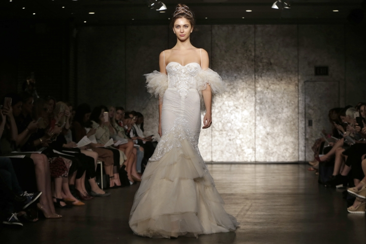 The collection of Inbal Dror is modeled during Bridal Fashion Week in New York, Oct. 5, 2017. (AP Photo/Richard Drew)