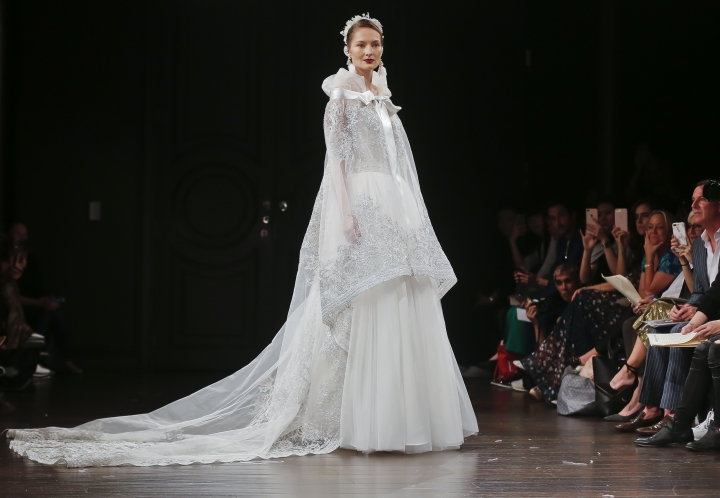 Bridal fashion from Naeem Khan collection is modeled Oct. 6, 2017, in New York. (AP Photo/Bebeto Matthews)
