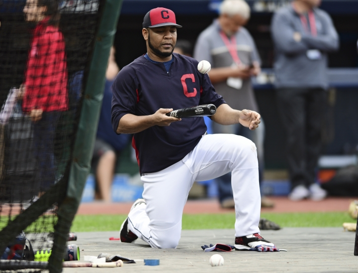 Cleveland Indians' Edwin Encarnacion balances the ball on his bat as he waits to take batting practice during a team workout, Tuesday, Oct. 10, 2017, in Cleveland. The Indians will play the New York Yankees Wednesday in Game 5 of the ALDS. (AP Photo/David Dermer)