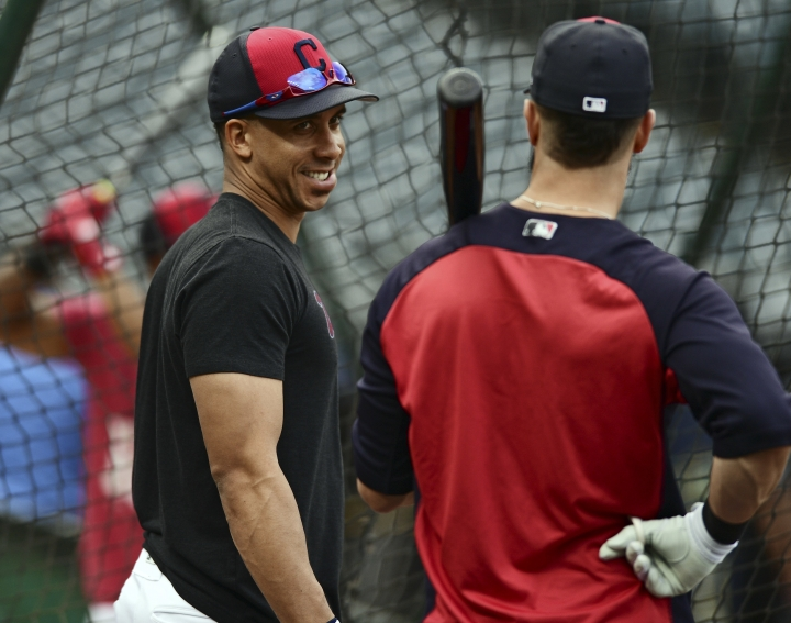 Cleveland Indians' Michael Brantley smiles at Yan Gomes as they wait to take batting practice during a team workout, Tuesday, Oct. 10, 2017, in Cleveland. The Indians will play the New York Yankees Wednesday in Game 5 of the ALDS. (AP Photo/David Dermer)