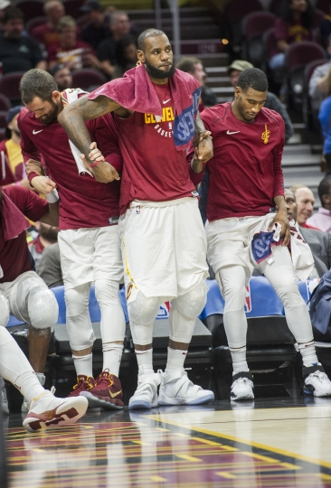 Cleveland Cavaliers' LeBron James, center, Kevin Love, left, and Iman Shumpert stand during a time out against the Chicago Bulls during the second half of an NBA preseason basketball game in Cleveland, Tuesday, Oct. 10, 2017. The Bulls won 108-94. (AP Photo/Phil Long)