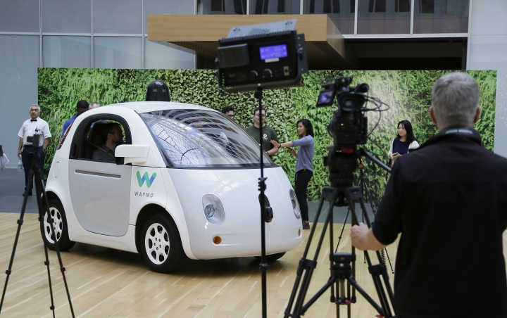 FILE - In this Tuesday, Dec. 13, 2016, file photo, the Waymo driverless car is displayed during a Google event in San Francisco. California regulators have taken an important step to clear the road for everyday people to get self-driving cars. The state's Department of Motor Vehicles on Wednesday, Oct. 11, 2017, published proposed rules that would govern the technology within California, where manufacturers have been testing hundreds of prototypes on roads and highways. (AP Photo/Eric Risberg,File)