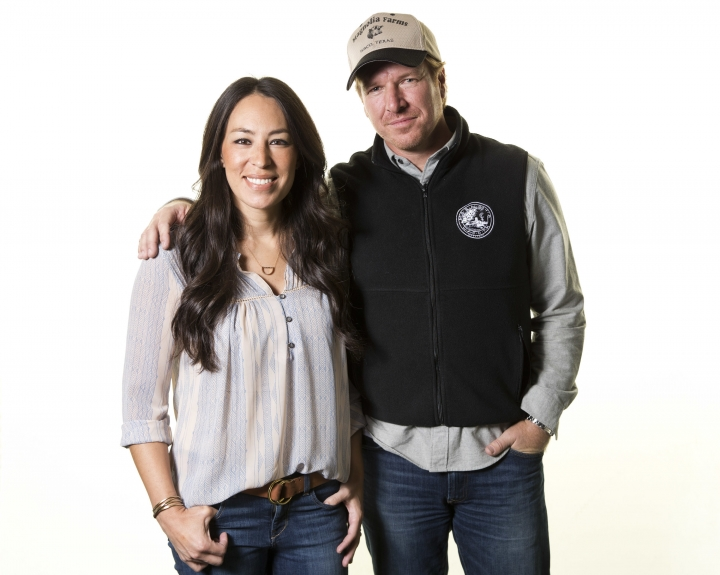 "FILE - In this March 29, 2016, file photo, Joanna Gaines, left, and Chip Gaines pose for a portrait to promote their home improvement show, ""Fixer Upper,"" on HGTV in New York. In an interview with People magazine released on Oct. 11, 2017, the couple cited a grueling 11-month production schedule as a reason for the show's end. (Photo by Brian Ach/Invision/AP, File)"
