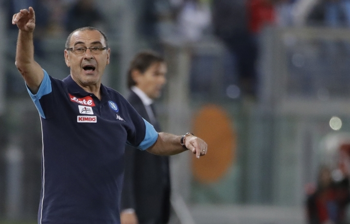 FILE - In this Wednesday, Sept. 20, 2017 file photo, Napoli coach Maurizio Sarri gestures during a Serie A soccer match between Lazio and Napoli, at the Rome Olympic stadium. Maurizio Sarri is approaching saint-like status with Napoli leading the league, Allegri has led Juventus to two Champions League finals in three years, and Luciano Spalletti has restored confidence at Inter Milan. (AP Photo/Alessandra Tarantino, File)
