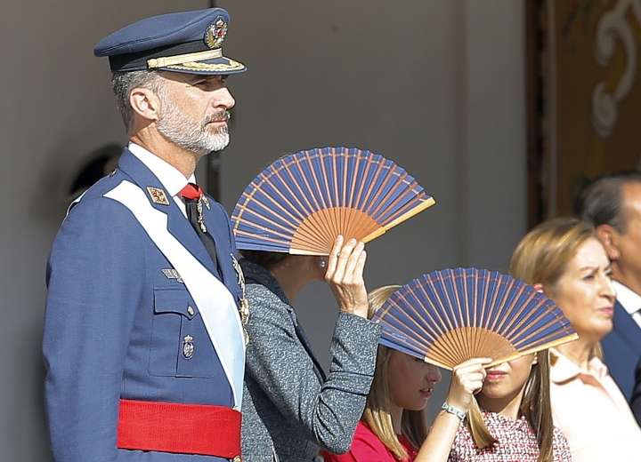 """Spain's King Felipe, Queen Letizia and Crown Princess Leonor and Princess Sofia attend a military parade during a national holiday known as """"Dia de la Hispanidad"""" or Hispanic Day, in Madrid, Spain, Thursday, Oct. 12, 2017. King Felipe VI is to preside over the annual colorful parade Thursday as Spain awaits a response to a government request to Catalonia to clarify by Monday if it has already declared independence, in which case Spain warns it may begin taking control of the region. (AP Photo/Paul White)"""