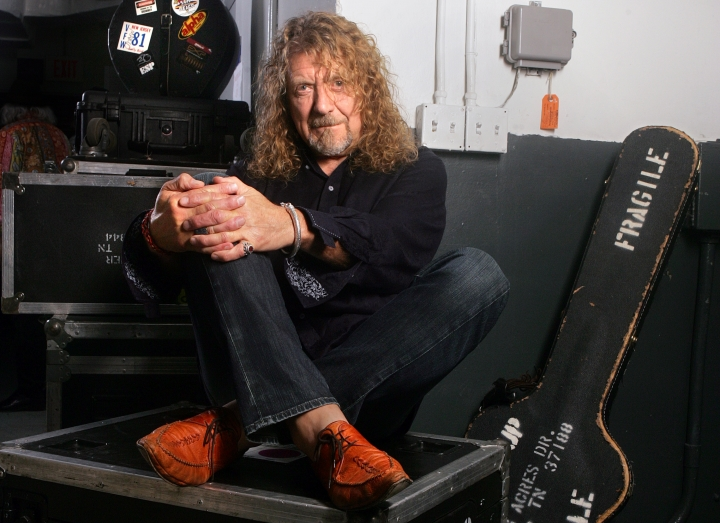 "FILE - In this July 30, 2010 file photo, singer Robert Plant poses for a portrait in Miami. The former Led Zeppelin singer has a new album, ""Carry Fire,"" out Friday, (AP Photo/Carlo Allegri, File)"