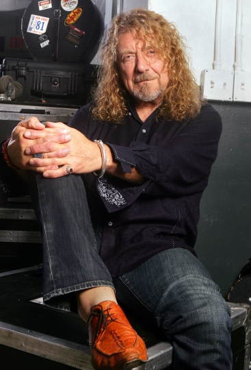 """FILE - In this July 30, 2010 file photo, singer Robert Plant poses for a portrait in Miami. The former Led Zeppelin singer has a new album, """"Carry Fire,"""" out Friday, (AP Photo/Carlo Allegri, File)"""