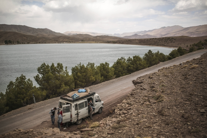 In this Friday, Sept. 22, 2017 photo, a family stops at Isli lake, one of two famous lakes in the region, during the annual festival of Imilchil, a small village in Morocco's Atlas Mountains. What started as an annual marriage festival has become an economic boon for a tiny Berber village tucked into in the foothills of Morocco's Atlas Mountains. Today, the event is arranged to coincide with a large three-day market that marks the end of the harvest season. (AP Photo/Mosa'ab Elshamy)