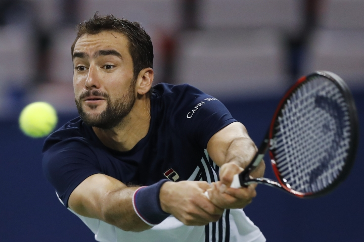 Marin Cilic of Croatia hits a backhand shot against Steve Johnson of the United States during their men's singles match in the Shanghai Masters tennis tournament at Qizhong Forest Sports City Tennis Center in Shanghai, China, Thursday, Oct. 12, 2017. (AP Photo/Andy Wong)