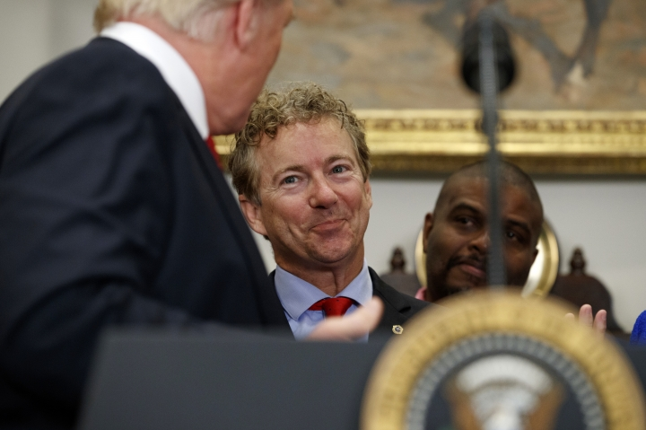 Sen. Rand Paul, R-Ky., smiles at President Donald Trump during an event to sign an executive order on health care in the Roosevelt Room of the White House, Thursday, Oct. 12, 2017, in Washington. (AP Photo/Evan Vucci)