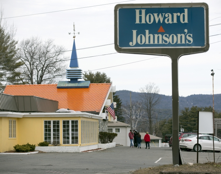 FILE - In this April 8, 2015, file photo, customers walk into Howard Johnson's Restaurant in Lake George, N.Y. Jonathan LaRock, the owner of the nation's last Howard Johnson's restaurant has been charged with sexually abusing or harassing more than a dozen female employees of his upstate business. (AP Photo/Mike Groll, File)