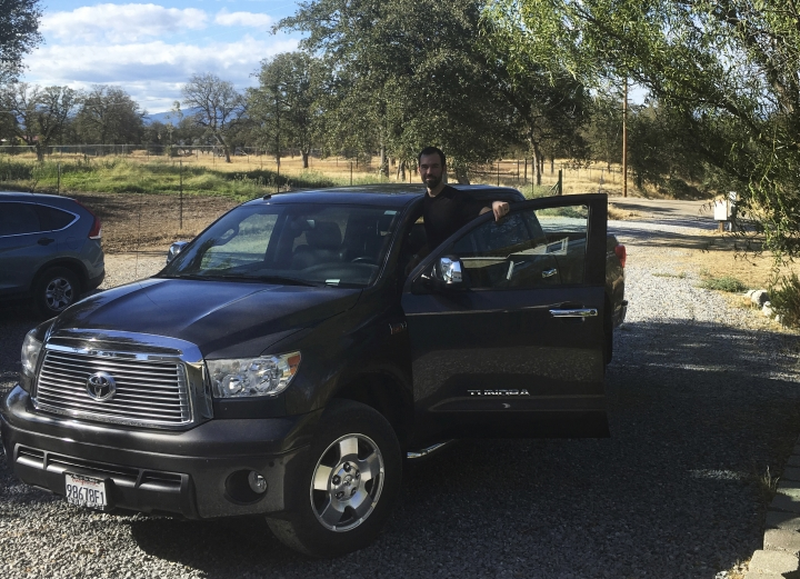 In this August 2017 photo provided by Kendall Bachman, Bachman poses at his home in Redding, Calif., with his limited edition 2011 Toyota Tundra CrewMax that's upholstered in leather from San Antonio-based Lucchese Boot Co. It sold for $50,000 when it was new; he bought it for $40,000 in 2013. (Courtesy of Kendall Bachman via AP)